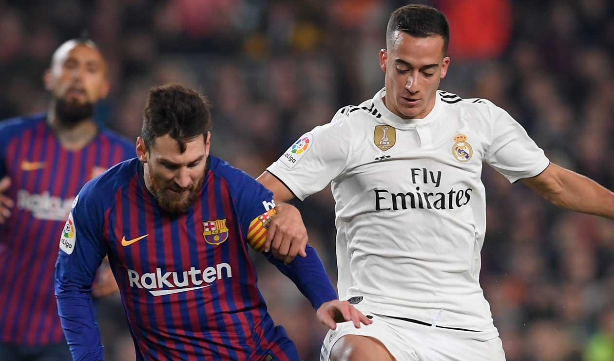 Messi ante la presión de Lucas Vázquez