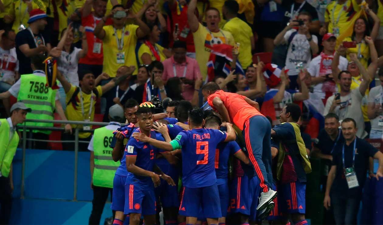 Colombia celebrando el primer gol a Polonia