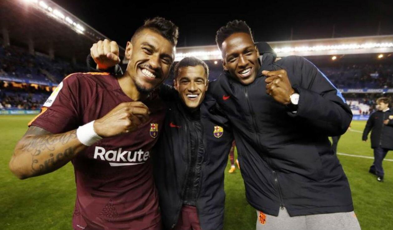 Paulinho, Coutinho y Yerry Mina en la celebración de la liga española con el Barcelona