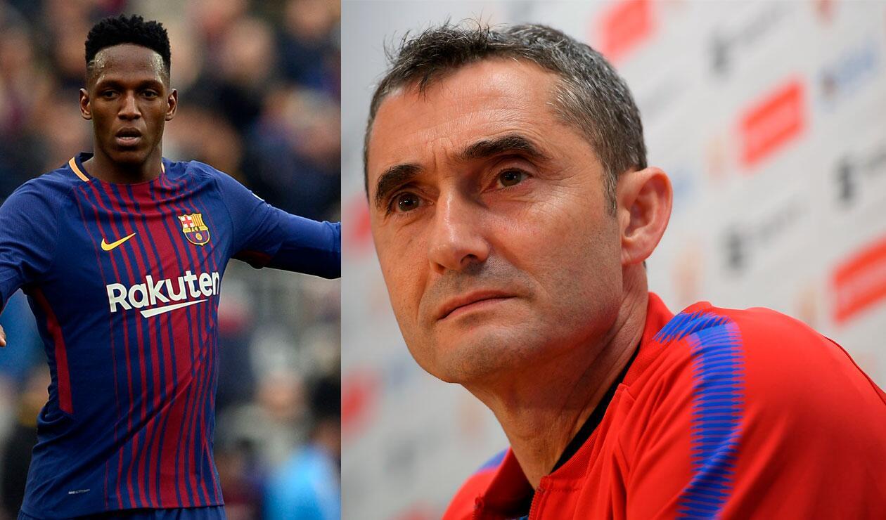 Yerry Mina y el técnico Ernesto Valverde, ambos del Barcelona