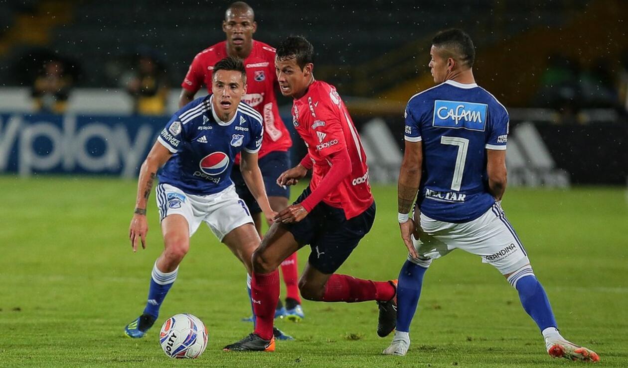 Henry Rojas, Jean Carlo Blanco y Ayron Del Valle en el juego entre Millonarios e Independiente Medellín