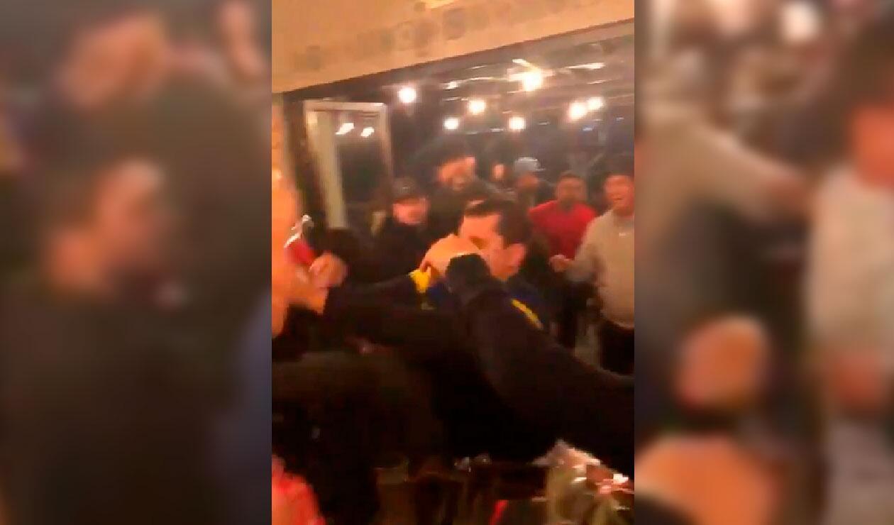 Video de aficionados de Boca y River en un restaurante en Madrid