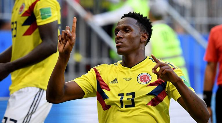 Yerry MIna celebrando un gol con Colombia en el Mundial de Rusia 2018