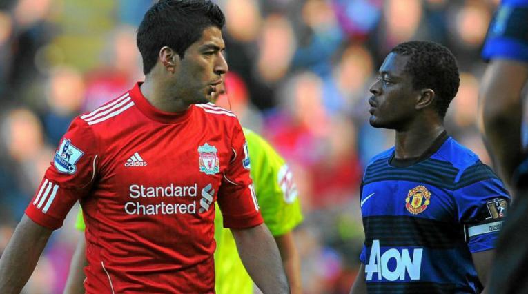 Evra y Suárez en la Premier League