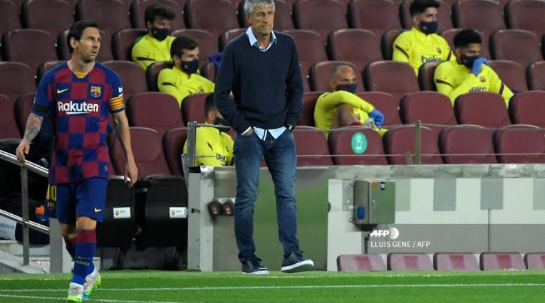 Quique Setién y Lionel Messi