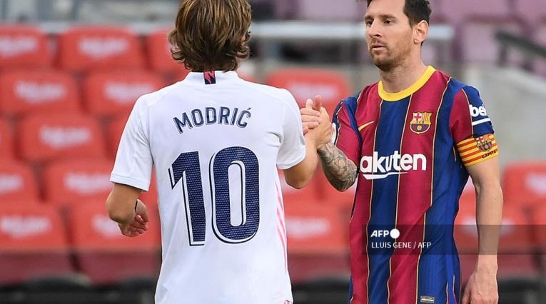 Luka Modric y Lionel Messi