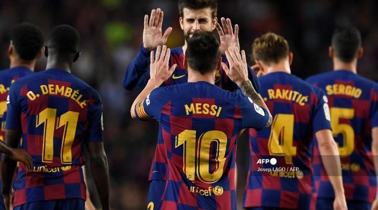 Pique y Messi