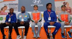 Brigid Kosgei, de Kenia y Feyisa Lilesa, de Etiopia, actuales campeones de la Media Maratón de Bogotá