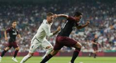 Carlos Bacca (AC Milan) y Sergio Ramos (Real Madrid)